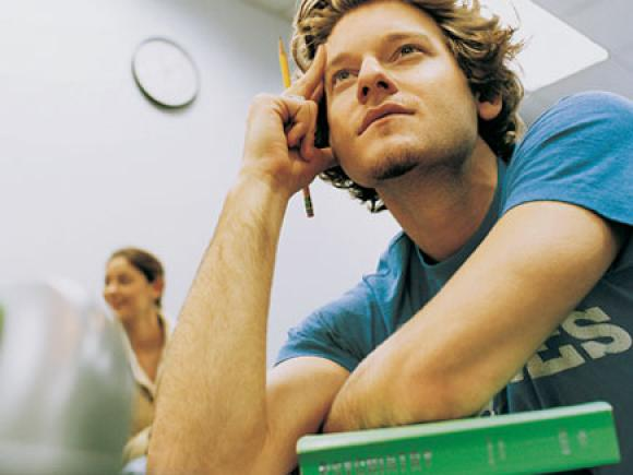 Photo of student listening to lecture